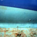 Photo, photographie de détail de coque de bateau du Finistère, bleu, vert, orange, noir @ Christophe Pluchon
